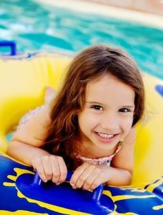 cute girl floating in the lazy river at The Oasis at Arizona Grand Resort