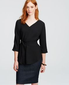 Perfect for teaching/// We love the deep neckline and rich hue of this belted tunic – a perfect pairing with the season's slim pants and skirts. V-neck. 3/4 sleeves. Self tie belt. Shirttail hem.