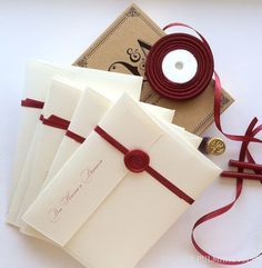 Create a belly band of ribbon, sealed with a special design or initial, to interior envelopes for invitations - or hand delivered packages.