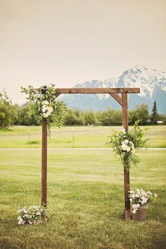 The wooden altar was dressed with lush arrangements featuring white roses, eucalyptus and other greenery.   	Venue: Paradise Alaska   	Event Coordinator: Blomma Designs