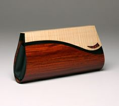 Petrea Clutch Description: Body: Marquetry using Cocobolo and Black-dyed Costello; Flap: Fiddleback English Sycamore with Double-dyed Box El...