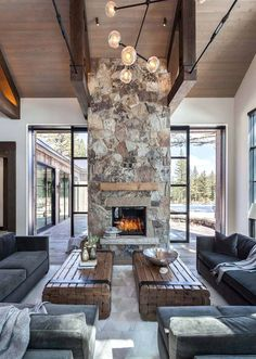 Most current Pic contemporary Stone Fireplace Concepts a chic contemporary cabin space with dark furniture, wood slab tables and a spectacular stone firep House Design, New Homes, Rustic House, House Interior, Contemporary Cabin, Fireplace Design, Home, Cheap Home Decor, Great Rooms