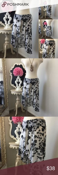 """🌺No Label  Chiffon Print  Skirt Wrap w/ Belt 🌺No Label  Gorgeous Chiffon Print  Skirt Wrap w/ Belt Loops - Black / Ivory Print - Waist Closer  -  Front Opening - Wear with Shorts - Leggings or Over a Bikini  $68 New Size: Medium - Waist is Aprox 30"""" Fabric :  🌺 Accessories Not Included But Are also for Sale  Please Check out my Other Items in my GIRLe B Posh Shoppe'  Like us on FB   www.facebook.com/girleboutique Thanks For Looking & Always Let your Clothes get All the Attention 💋 ❌⭕️…"""