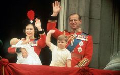 1964: The Queen, holding Prince Edward, waves to the crowds from the balcony at Buckingham Palace, during the Trooping of the Colour. She is joined by Prince Philip and Prince Andrew.  Picture: Fox Photos/Getty Images