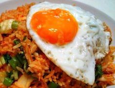 Nasi goreng is known as fried rice variants commonly found in Indonesia, Malaysia, Singapore and Brunei. In my this video Nasi Goreng Recipe you will learn h. Nasi Goreng, Mie Goreng, Stir Fry Kimchi, I Have Breakfast, Making Fried Chicken, Korean Dishes, Korean Food, Indonesian Cuisine, Rice Dishes