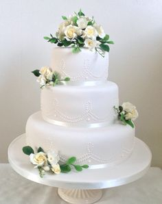 White Wedding Cake with sugar roses. Made by Sue's Cakes