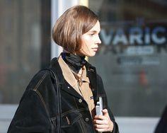 Layers: oversized dark denim jacket, button down top, and neckerchief.