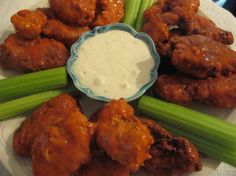 TSR Versionof Chili's Boneless Buffalo Wings by Todd Wilbur 1 cup all-purpose flour 2 teaspoons salt 1/2 teaspoon black pepper 1/4 teaspoon cayenne pepper 1/4 teaspoon paprika 1 egg 1 cup milk 2 chicken breast fillets 4 -6 cups vegetable oil 1/4 cup hot sauce (Crystal or Frank's Louisiana) 1 tablespoon margarine