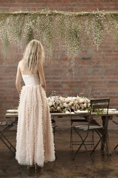 Love the look of the hanging baby's breath. Pretty alternative around table area or bride/groom table
