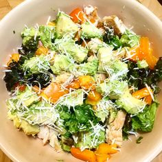 Roman salad with sweet peppers, avocado, grilled chicken and parmesan cheese. Dressing? Lemon, olive oil, salt and pepper.