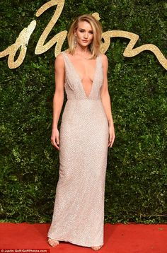 Beauty: Rosie Huntington-Whiteley, who showed some skin in a very low-cut Burberry gown as she arrived at the British Fashion Awards on Monday night
