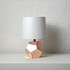 Shop Geometric Rose Gold Lamp.  If you're having a rocky time decorating your home, this table lamp will make things go a bit more smoothly.  It sports a rose gold base with a unique geometric design that will complement any room in the house. #luxurybedroom