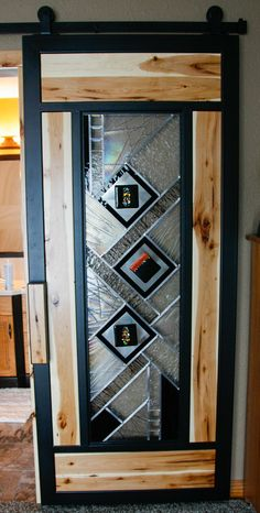 sliding barn door with stained glass and hickory insets