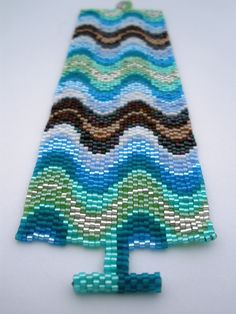 Waves of Color Peyote Stitch Cuff. $63.00, via Etsy.