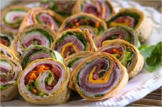 your guests can sample a variety of each when you slice the rolled up sandwich wraps into individually-sized pinwheels.