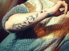 demi lovato's bird tattoo. maybe a smaller, more delicate version.