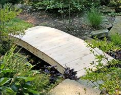 """8' Red Cedar Crescent Moon Plank Bridge by Fifthroom. $599.00. 8'L x 36""""W; max span of 80""""; capacity: 400 lbs. Free Shipping. Features: (3) 2 x 8 Support Beams. Hardware: Zinc Plated Steel. Protected by 1 year limited warranty. This charming Crescent Moon Plank Bridge, though simple of design, carries a lot of weight - literally! Hand-crafted from solid western red cedar, it possesses an inherent durability and decay-resistance that will support a steady strea..."""