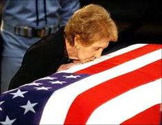 Nancy Reagan kisses the casket Ronald Reagan, we should all be so lucky to have a love like those two had, this image makes me have to catch my breathe every time I see it.