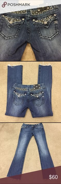 """🦋 Miss Me bling # JP6152B med wash jeans sz 28! 🦋 Miss Me stunning bling <a class=""""pintag searchlink"""" data-query=""""%23JP6152B"""" data-type=""""hashtag"""" href=""""/search/?q=%23JP6152B&rs=hashtag"""" rel=""""nofollow"""" title=""""#JP6152B search Pinterest"""">#JP6152B</a> med wash jeans sz 28! These jeans have all rhinestones, crystals, mother of pearl and rivets intact. Black leather patch label. Lovely silver stich wish cool front pocket. These are preloved in great condition. They are factory 34"""" inseam but have been trimmed at the bottoms versus hemmed. Inseam is now 31"""". Outseam is 39"""". The strings on the bottoms now create character. Rise is 8"""". Pics 1 and 2 are rep of fit. Miss Me Jeans Boot Cut"""