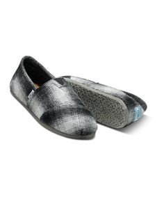 Stay cozyandlook stylish: this is the wool version of the original TOMS shoe that started it all. Styled like the traditional Argentinian alpargata, this slip-on pair boasts the classic TOMS toe-stitch, elastic V goring for easy on and off, and a comfortable, cushioned suede insole....