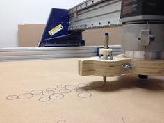 A simple wood and plastic adapter that turns a ShopBot into a pen plotter