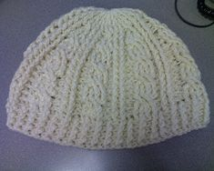 Cable crochet beanie.  Cables scare me but they're so pretty!  Add a giant pom-pom up top and you have the perfect hat.