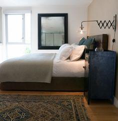 Industrial bedroom... love the lamp