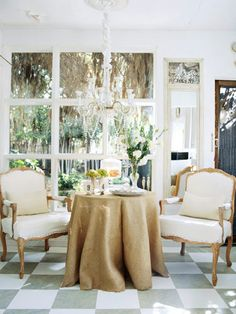 Cottage Style Rooms Rugged Elegance:   This cottage breakfast room has eclectic style. Antique chairs pull up to a table covered in rustic burlap. Silver and crystal serving pieces add sophistication and glam.