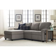 Copenhagen Reclining Sectional is the all-in-one sectional sofa you've been waiting for. Serta designed this versatile storage sectional with a reclining seat and a functional chaise lounge, just the thing for making the most out of your space. The clean, rolled arm design and woven fabric upholstery bring a refined touch to any living room, den or study. Simply lift the chaise upward and you'll find extra storage perfect for pillows, blankets, games and more. Available in right-side ...