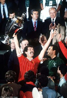 Graeme Souness as Liverpool captain holds aloft the European Cup trophy after his team's win in 1984.