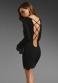 Gorgeous black lace dress with dip back and criss cross design.  Hot!  NIGHTCAP Spanish Pricilla Dress in Black at Revolve Clothing - Free Shipping!