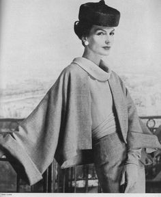 Joanna McCormick, March Vogue 1957 Wearing a orange-pink wool suit with a orange chiffon blouse, by Jeanne Lanvin.