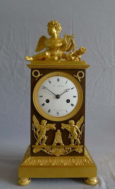 Beautiful French Empire ormolu and patinated bronze clock of Cupid signed Louis Mallet. -