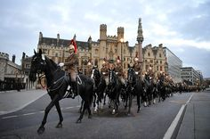 The Household Cavalry Mounted Regiment, HCMR, form up in the early hours of this morning Friday, June 1, 2012 at the Palace of Westminster, London during the Queens Diamond Jubilee Procession rehearsal. The patriotic bunting is ready, the golden carriage on standby, the boats freshly painted, the shops filled with royals souvenirs. The normal ebb and flow of British life gives way in the next four days to a series of street parties, flotillas, outdoor concerts and more