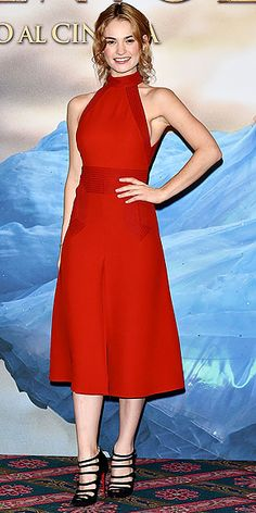 Lily James's Magical Red Carpet Moments: See All the Cinderella Star's Chic Looks | BIBBIDI-BOBBIDI-BOMBSHELL | Surprise! The British star has a sultry side. She shows if off in this red Gucci halter design, plus, strappy black Christian Louboutin heels at the Milan photo call.