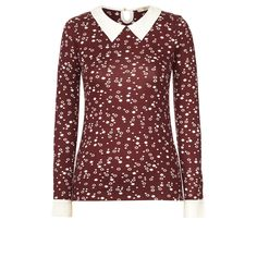 Orla Kiely: Cute printed top with with cream woven collar and cuffs. Keyhole opening at back neck with button to fasten.     Length: 61cm