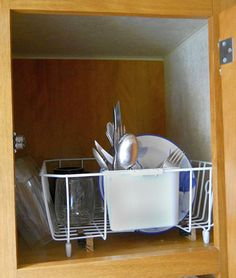 Keep dishes safe while on the move in your RV. Secured in cupboard by cup hooks or two cupboard latches (as shown)