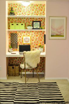 Love the wallpaper in the open area behind shelves.