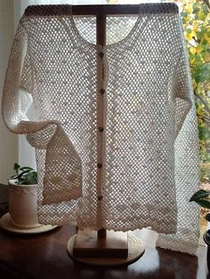 https://www.facebook.com/craftncreationsbysharonElegant Crochet Top for both summer and winter. Wear with a T-Neck or a summer shell for stunning contrast with the white, open, lace-work. Fits up to 33 inch chest. 100% Cotton. Wash warm, gentle cycle - lay flat to dry and iron as needed.