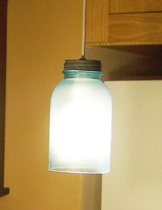 Mason jar lamp shade made by frosting a 1.5 quart mason jar with the bottom cut out. Don't do this without cutting out the bottom if you are using incandescent bulbs!