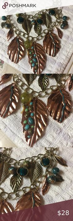 """NECKLACE- COPPER, TURQUOISE LEAVES 🤩Striking Fashion Jewelry Copper Leaves decorated w Turquoise, Olive colored stones, crystals, on Two Gold-tone, attached chains that have smaller gold leaves & ball charms.Some are translucent, deep tones of Blue/Green, w small bronze beads framing them. Length 12.5"""" with a 3"""" extender chain Main Bottom Leaf 3.5""""x 2"""" Bottom Side Leaves 3"""" x 2"""" 🚭, pet friendly home Jewelry Necklaces"""