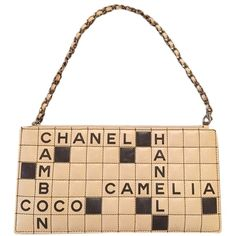1a6785e74c42e Pre-owned Chanel Black   Tan Lambskin Leather Cambon Crossword Clutch  ( 629) ❤ liked on Polyvore featuring bags