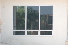 This is Milgard Aluminum Awning window below a fixed Casement.  It give a nice modern look.  You can buy it at http://www.1stwindows.com/members/milgard/aluminum/index.htm