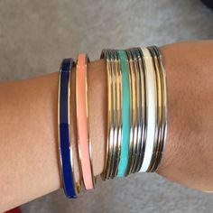 The Limited Bangles Bundle Worn once. Bundle of 12 bangles from the Limited. 4 different colors in enamel, 4 silver, 4 gold. No tarnish no signs of wear The Limited Jewelry Bracelets
