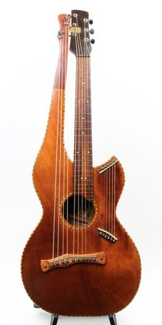 By the time Norwegian immigrant Chris J. Knutsen attended the Alaska-Yukon-Pacific Exposition in 1909, Knutsen was well established as a builder/innovator of stringed instruments of the harp-guitar variety, and held many patents for improving his instruments. This 16 string Harp guitar showcases the influence that Hawaiian style instruments had on Knutsen, featuring rope marquetry, and highly flamed Koa wood throughout (Koa possibly purchased at the Hawaii Building at the 1909 AYP ...