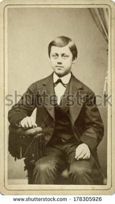 USA - CONNECTICUT - CIRCA 1872 - A vintage Cartes de visite photo of a young boy sitting in a tasseled chair. He is wearing a suit, vest and tie. A photo from the Victorian era. CIRCA 1872