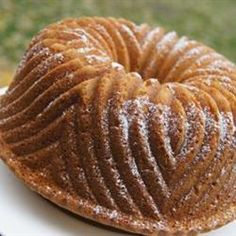Wine cake, My dad taught me to make this in 1964, easy and moist, Yellow Cake Mix, sm vanilla pudding, 4 eggs, 3/4 cup oil, 3/4 cup sherry, tsp nutmeg, pour into oiled and floured bundt pan,cook 45 minutes at 350, DELISH !