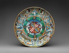 Tazza Decorator: Lustered by Maestro Giorgio Date: 1524 Culture: Italian, Gubbio Medium: Maiolica (tin-glazed earthenware) Dimensions: Overall (confirmed): 1 5/8 x 10 9/16 in. (4.1 x 26.8 cm) Classification: Ceramics-Pottery Credit Line: Gift of V. Everit Macy, in memory of his wife, Edith Carpenter Macy, 1927 Accession Number: 27.97.38 Tazza