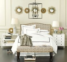 Our new favorite fabric, the Dodie Print, feel playful and super glamorous in this bedroom, especially when paired with gilded sunburst mirrors!