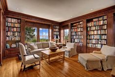 Traditional Library with Crown molding, Hardwood floors, Built-in bookshelf